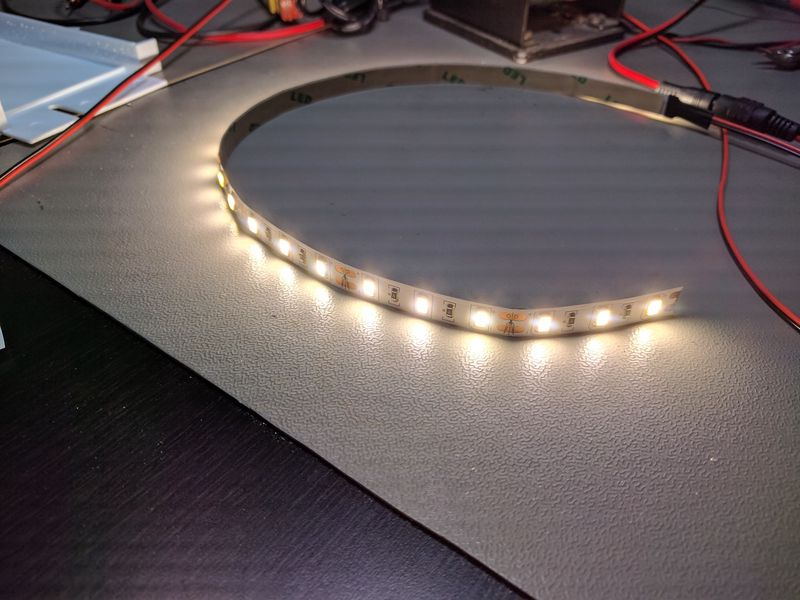 LED strip lit, lying on bench