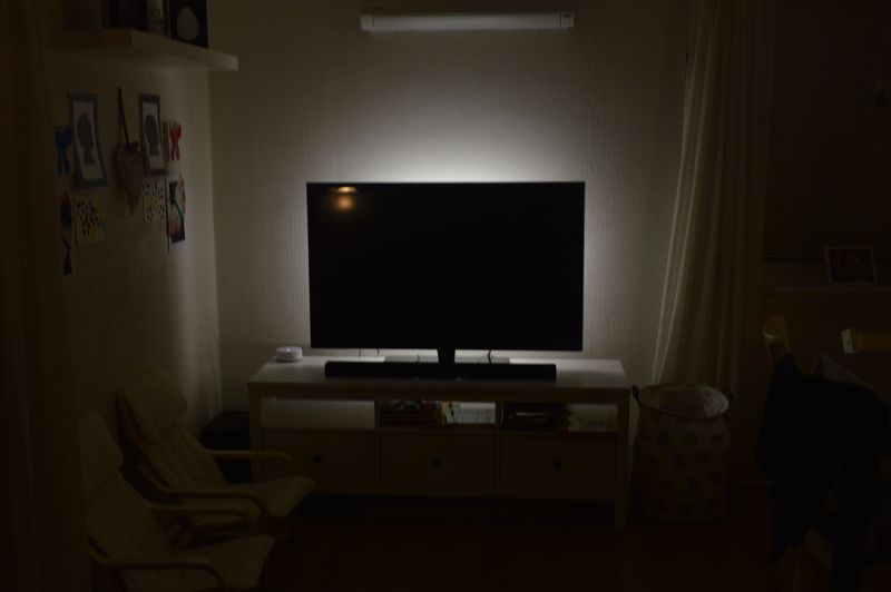 TV in dark room, with bias lighting