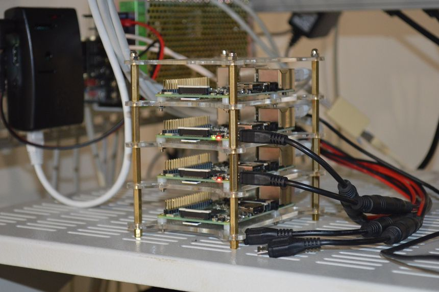 Stacked Raspberry Pi boards, with common power supply