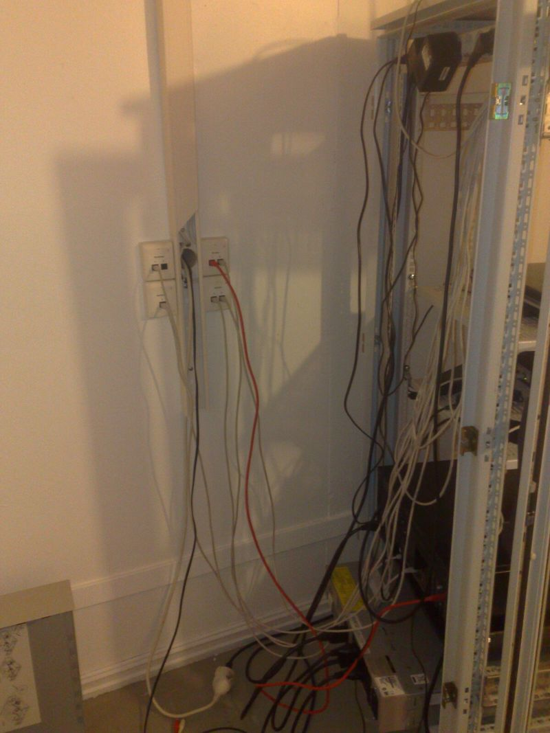 Backside of server rack, with power and network cables