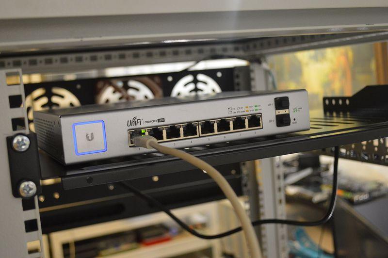 Unifi 8 port PoE switch, on shelf in rack