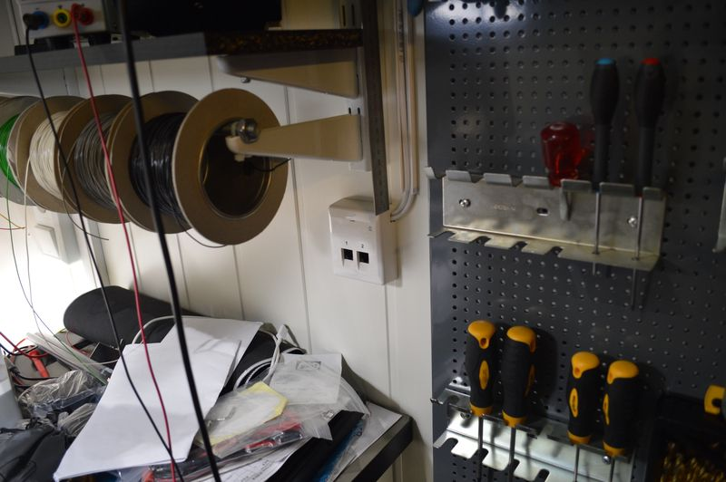 Network outlet on wall, next to wire spools and tools