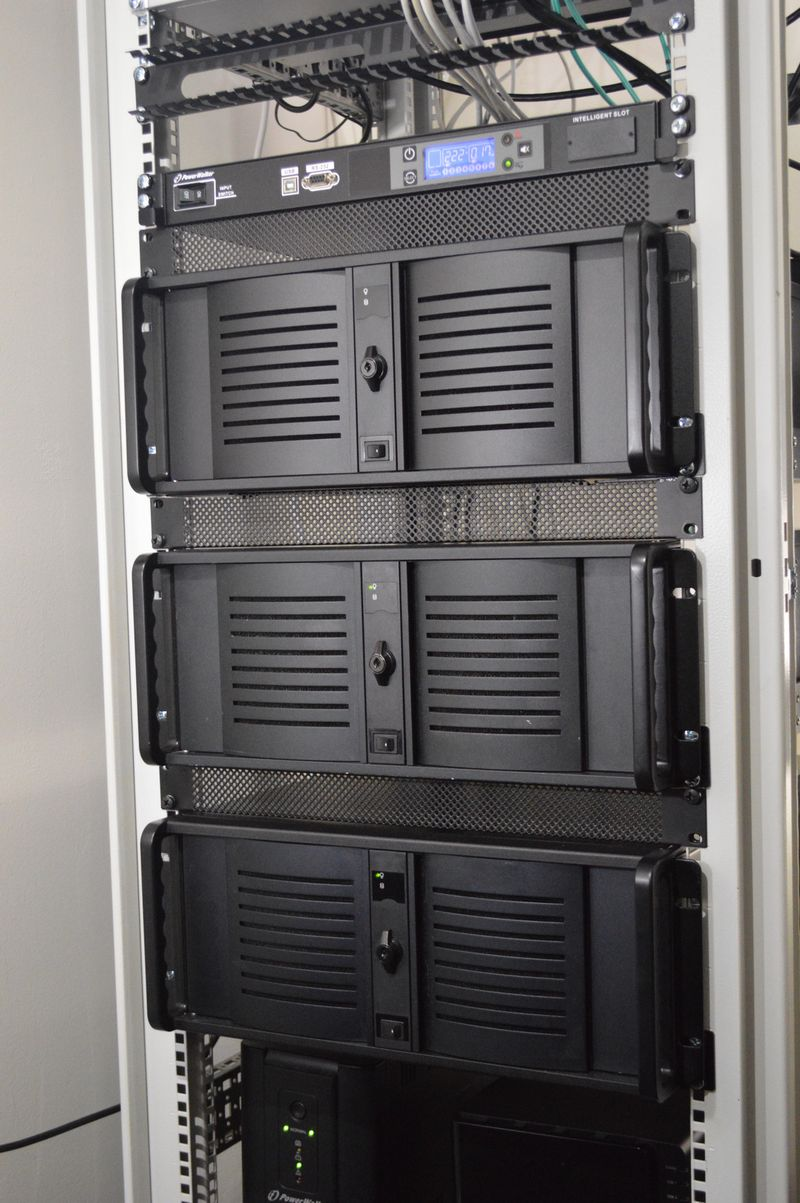 Three servers and UPS in computer rack
