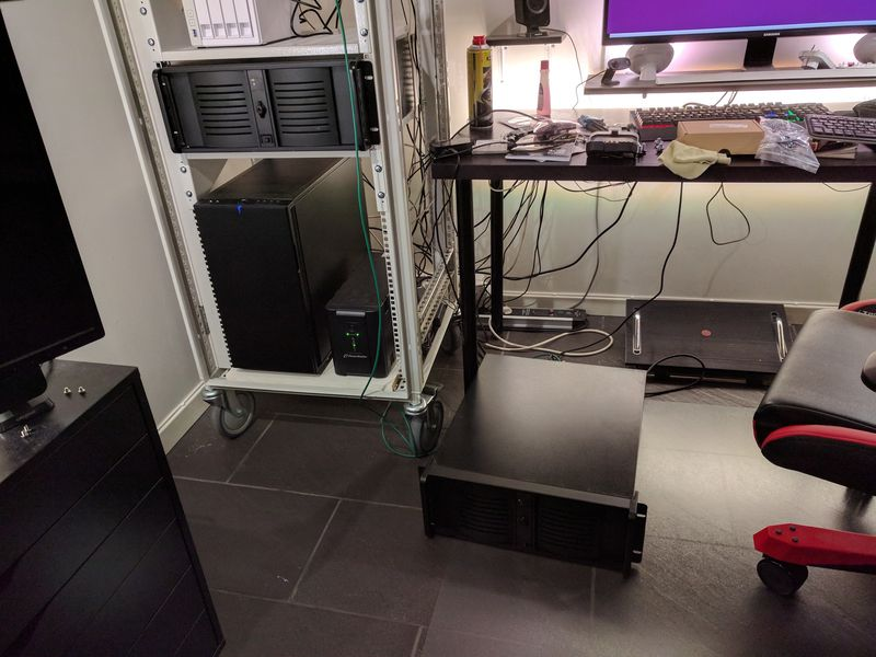 Server lying on the floor, next to computer rack