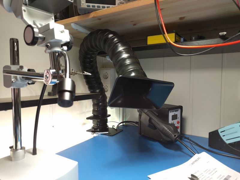 Fume extraction arm with hood, on electronics workbench